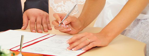 newlywed signing paper